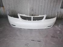 Бампер белый шевроле лачетти седан