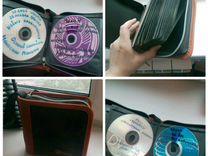 Стойка для дисков, книжка с фильмами